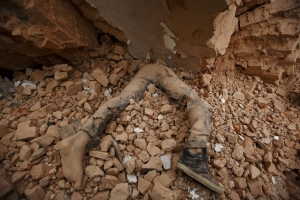 Image: Body of a victim lies trapped in the debris after an earthquake hit, in Kathmandu